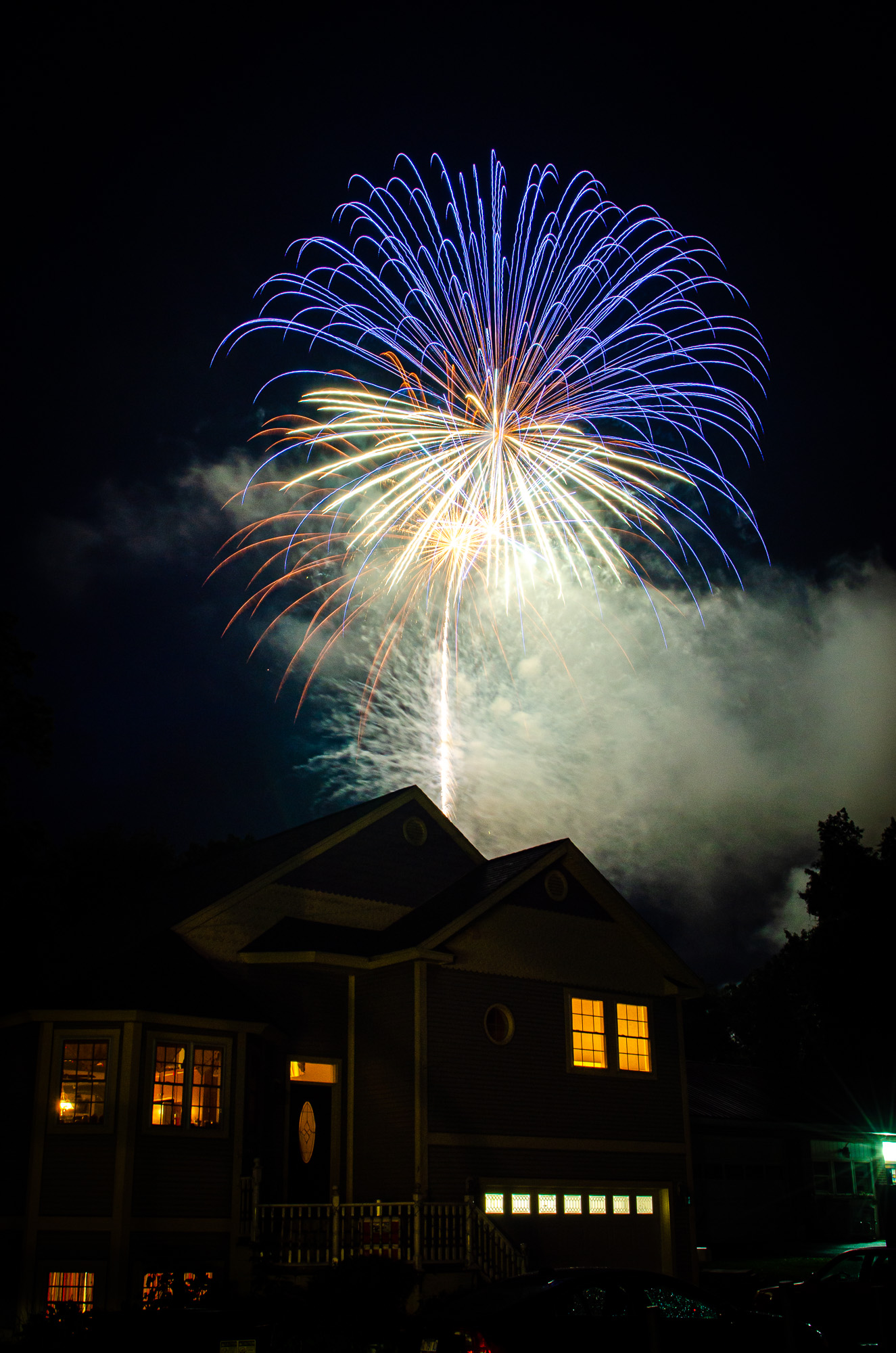 This photo was taken at a friends house in town and for some reason, my town likes to move the fireworks around every year so you really never have a definite idea where they will be launched! I decided to leave the house in the foreground to add some interest. Over the years, it has become one of my favorite shots. Taken in 2013 with a Nikon D7000 + 17-55 2.8 in Waterbury, VT