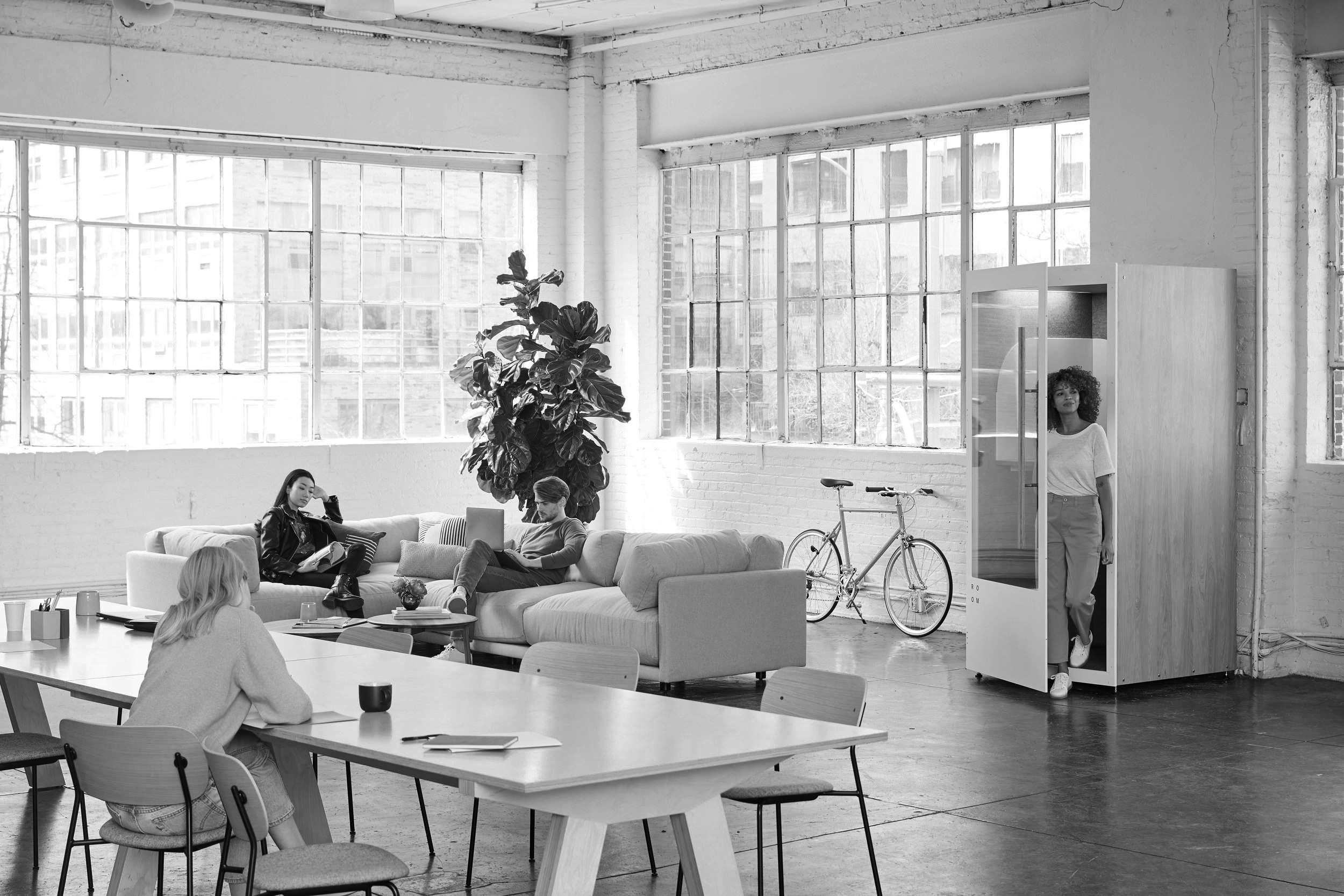 image of a loft room with four people interacting with the space