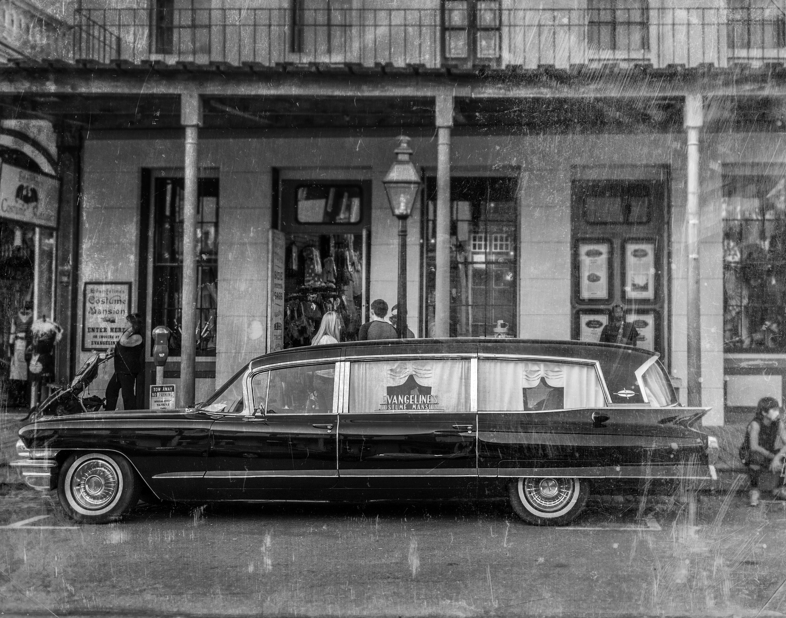 Evangeline's Costume Mansion Hearse parking on the street of Old Sacramento