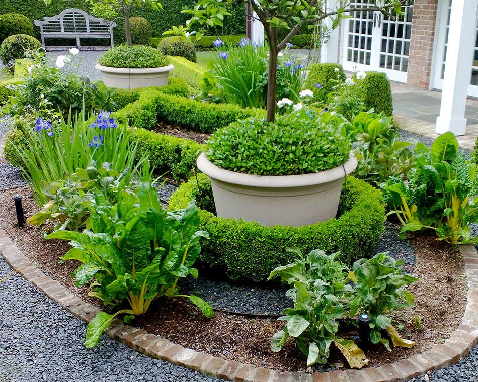 Backyard elliptical, parterre vegetable garden by Lanson B. Jones & Co.