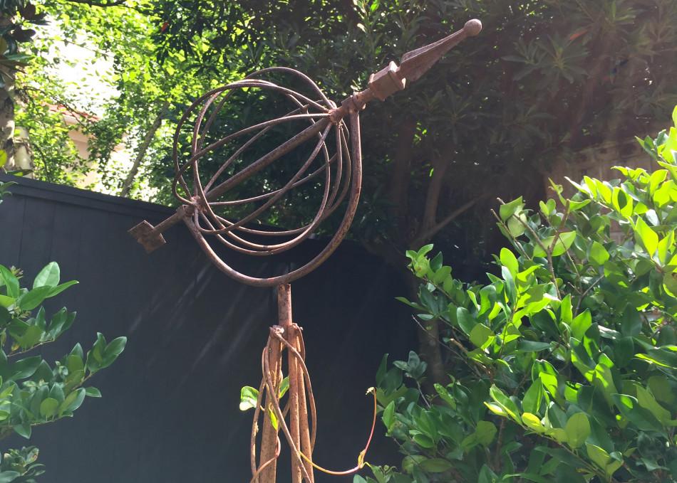 Left:  Decorative iron sundial.