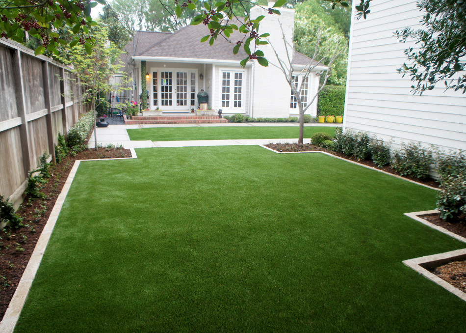 Paving with clean lines and artificial turf replace what was muddy, underutilized space.