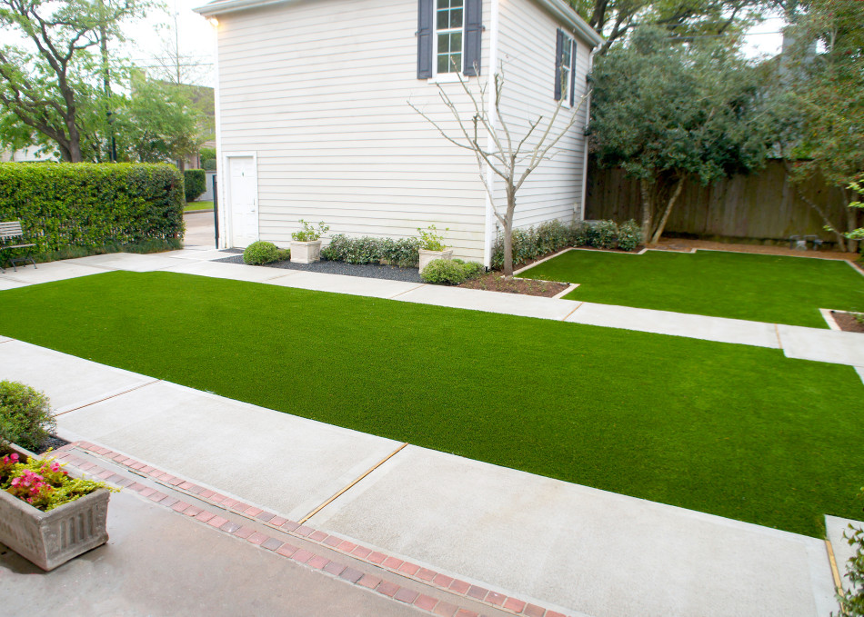 A concrete walk frames the children's play lawn and offers a path for bikes.