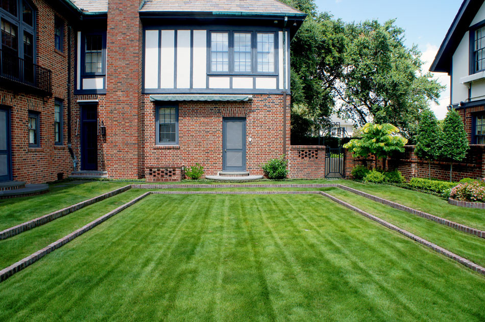 Eagleston Hollies, affectionately pruned to jewel-shapes, add visual interest to the view from the grand terraced lawn.
