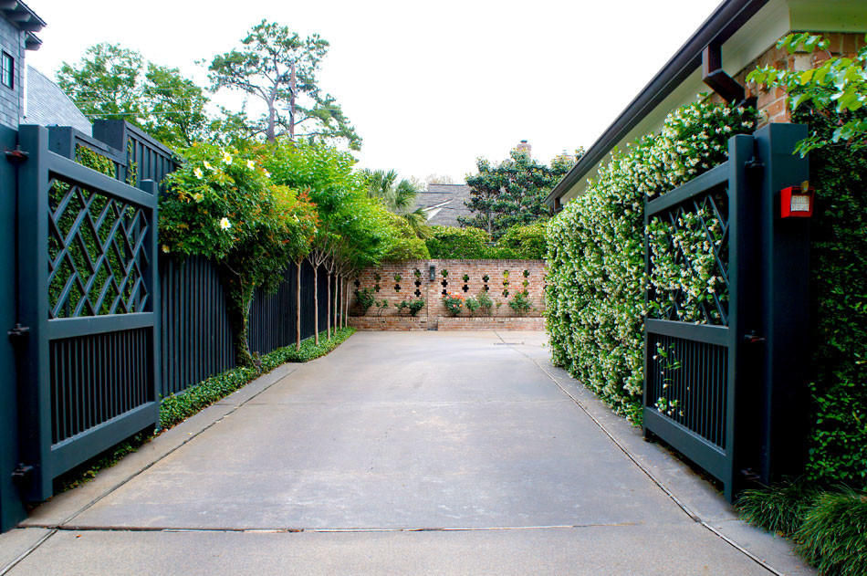 View leading into the garage area. Back wall has a built-in brick planter which holds an expansive rose garden.