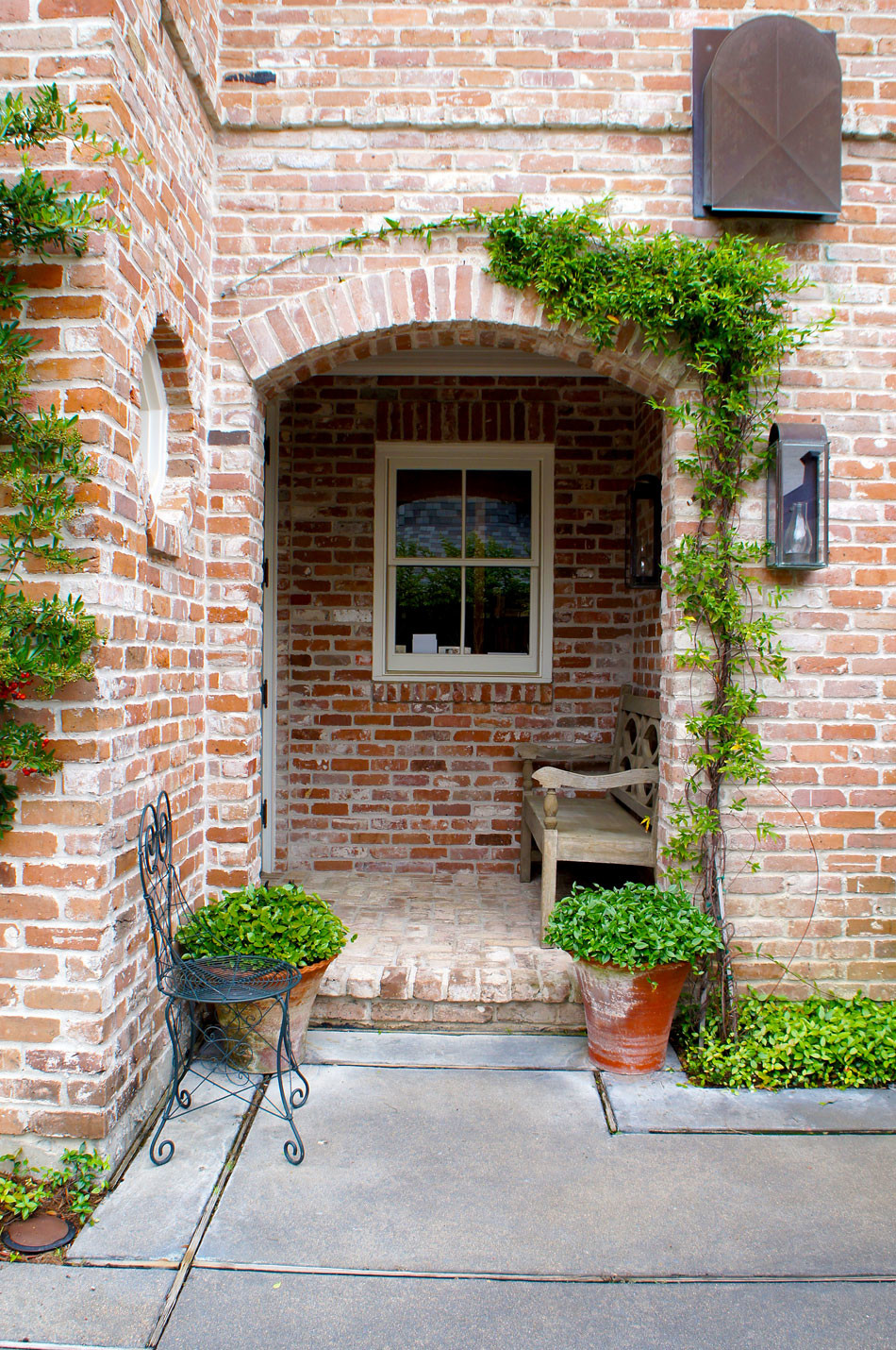 Arch doorway with climbing wisteria.