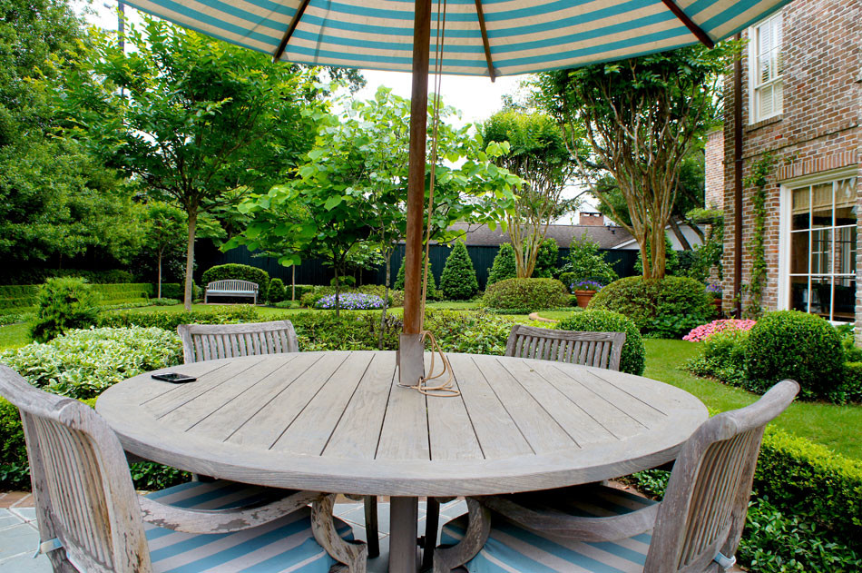 View of backyard from poolside seating area.