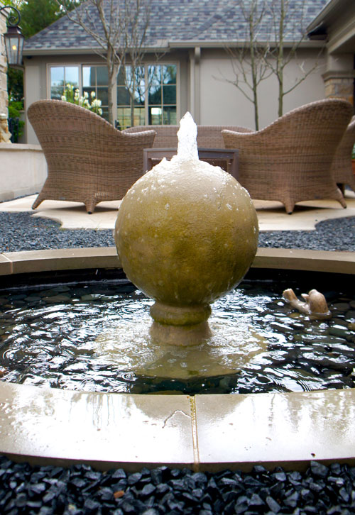 Right:  Close up of finial fountain. Shows mexican beach pebbles and ornamental stone seal.