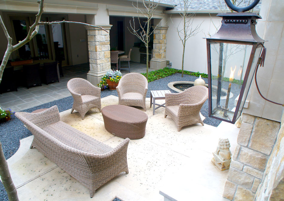 View of formal outdoor seating area near outdoor fireplace.