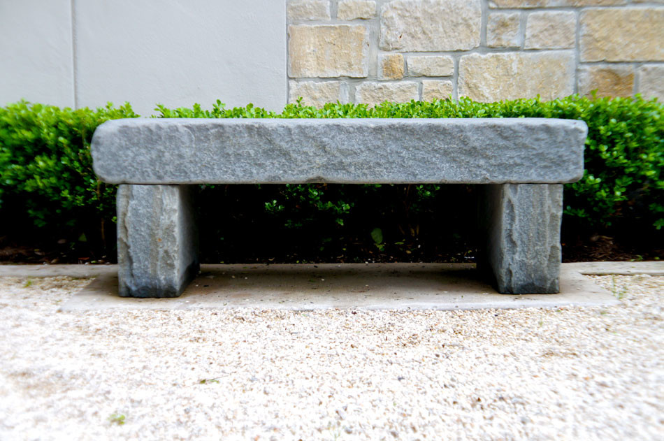 Custom stone bench mirrors another identical one in this french entryway.