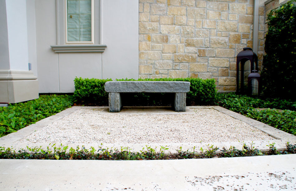 Custom stone bench sits on a concrete frame with a rock salt finish.