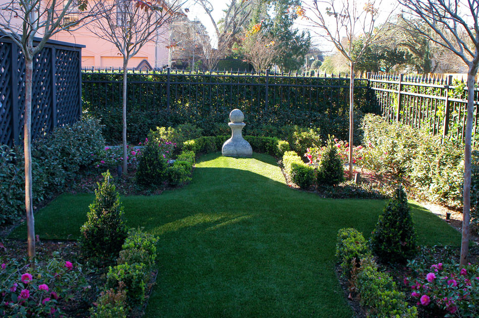 Cement chess piece finial in tradition french garden.