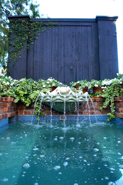 Left:  Fountain water feature with seashell fountain.