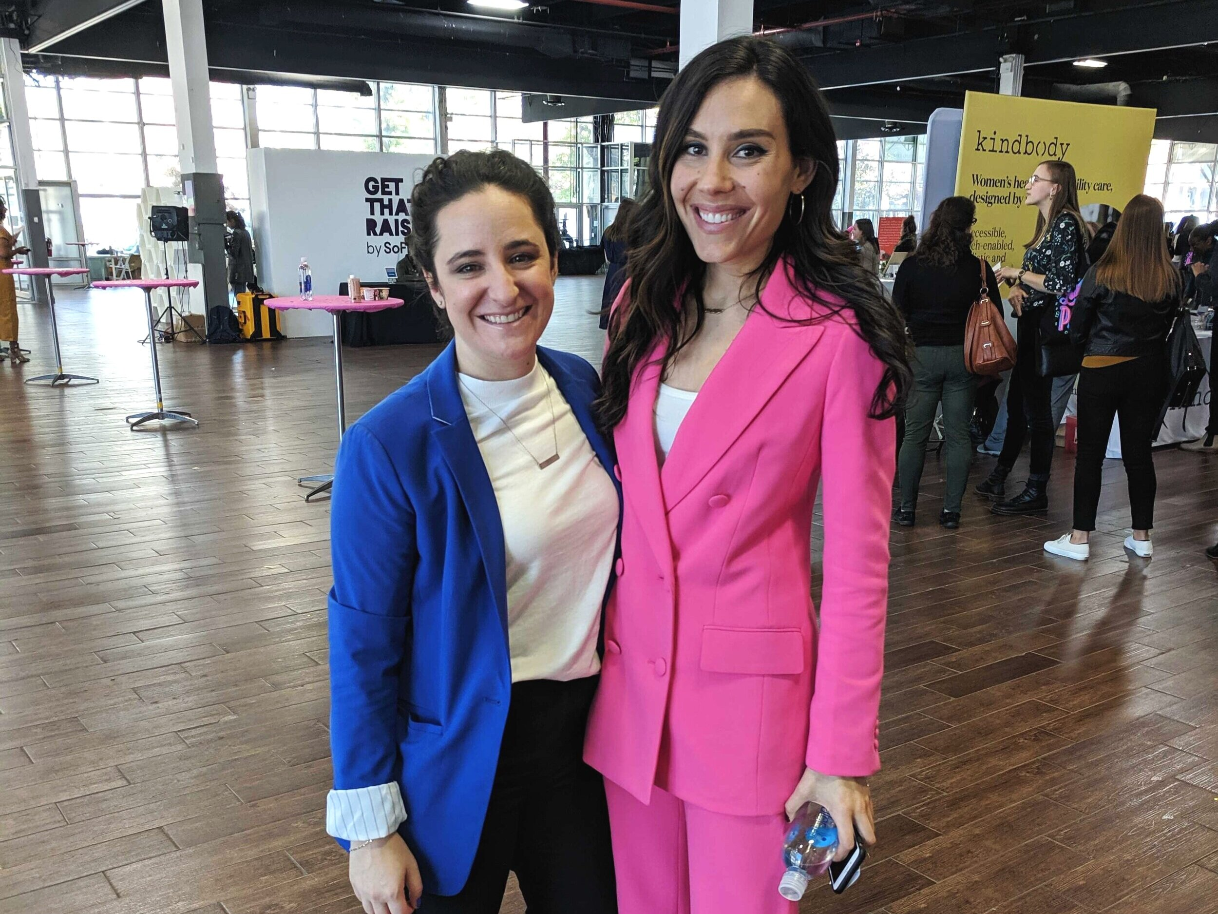 Claire Wasserman (pink) and her partner/co-founder Ashley Louise at Get Money, Get Paid.