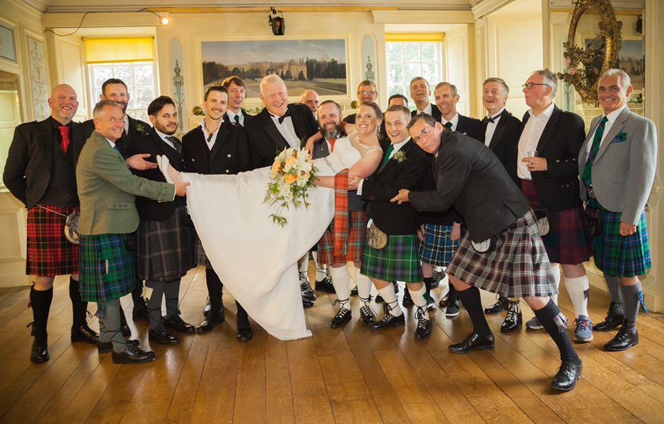 A sea of men in kilts surround the new groom and bride, Chris and Marlies Morrison, as they rejoice inside Fingask Castle near Perth, Scotland on their wedding day last month.