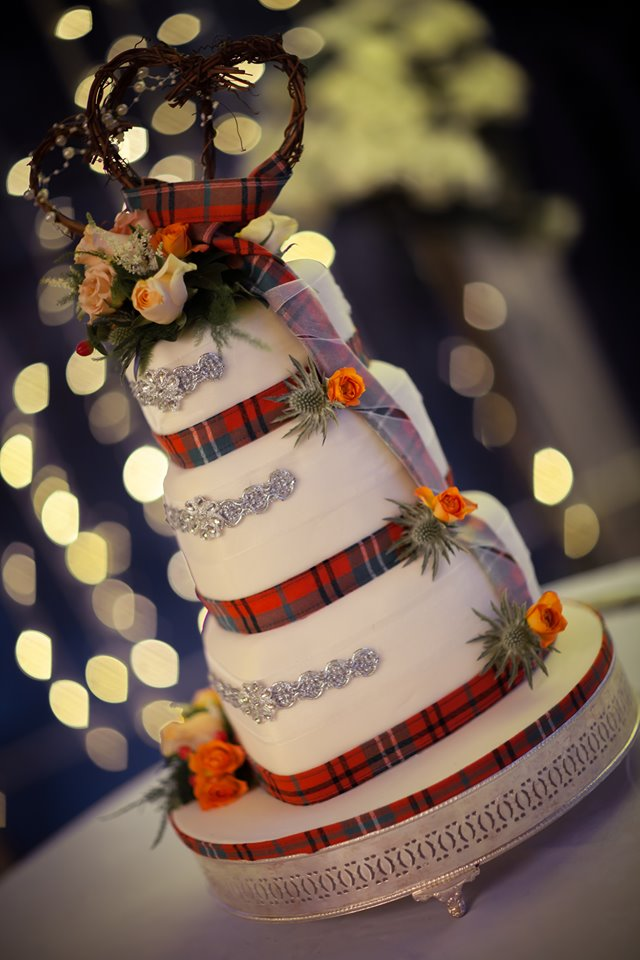 Ana Morrell (the baker) decorated the gorgeous wedding cake for the Morrisons in traditional Scottish tartan. The serving of cake is a highly anticipated social experience in British Culture.