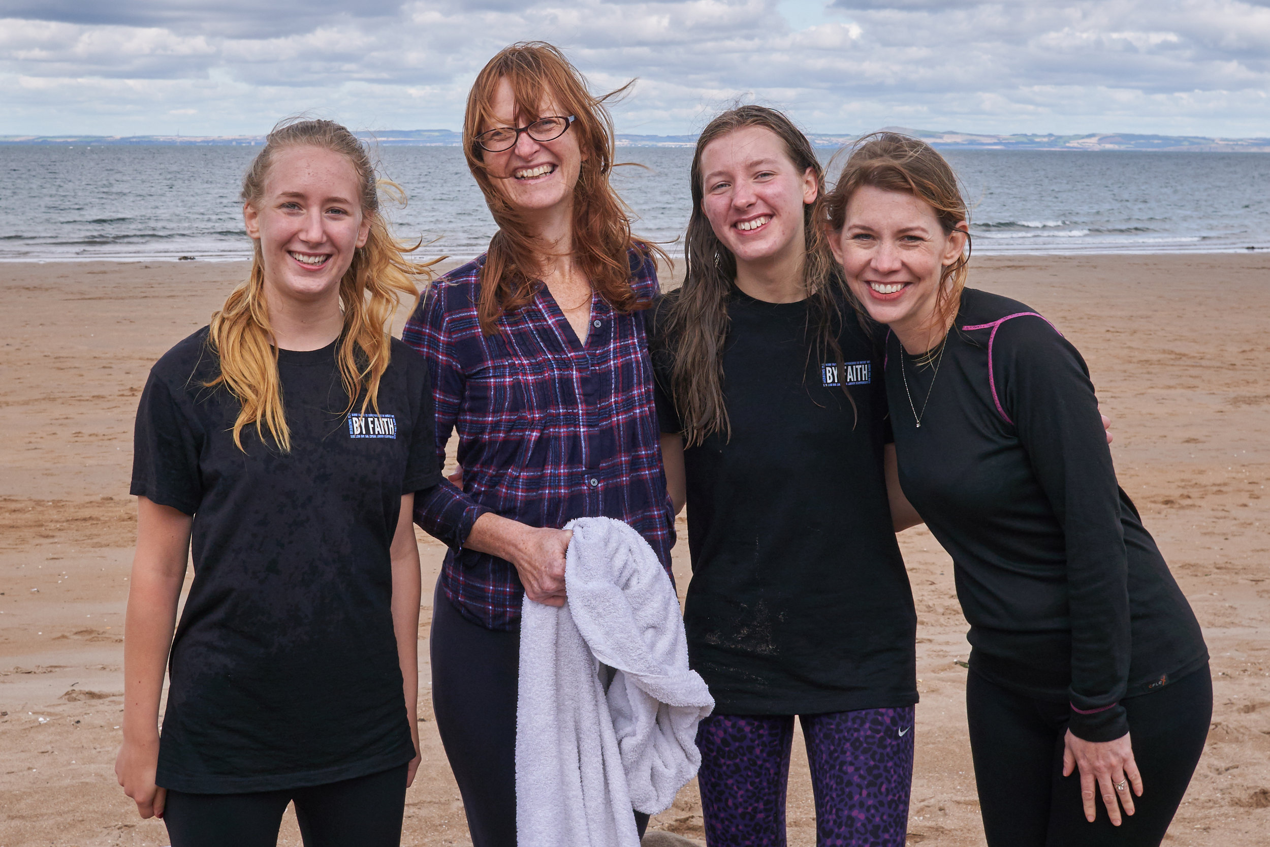 Last summer in Edinburgh, three generations of women baptized Megan Gardner (third from left) in the cold waters of the North Sea.