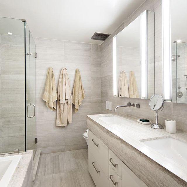 Monolithic bathroom in wooden beige marble from @tilebar #bathroomdesign #loft #thinkcreatedesignbuild