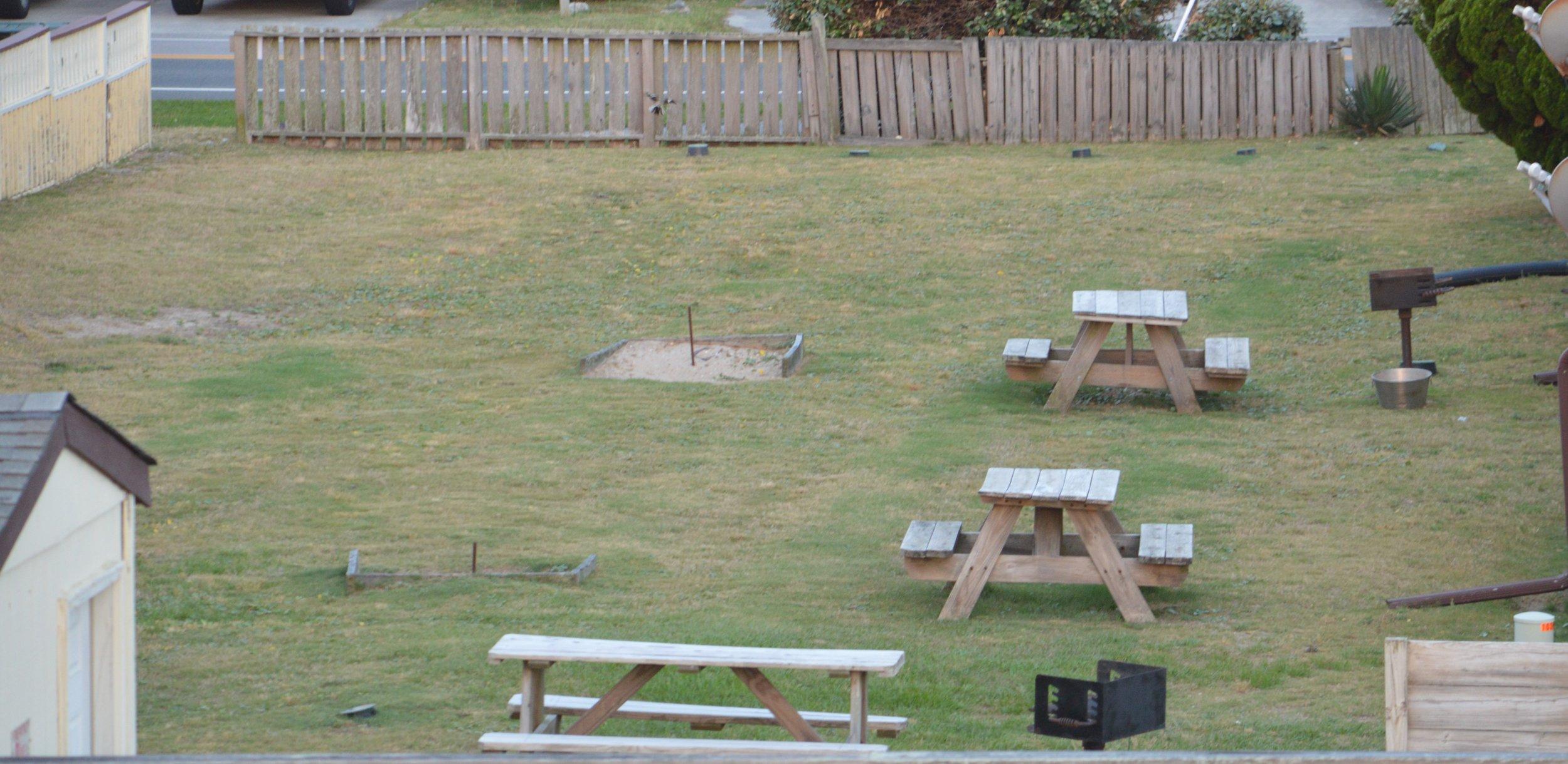 Picnic tables, grill and horseshoes adjacent Villa's 7 & 9