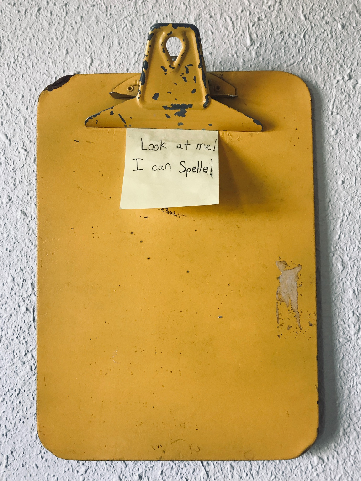 vintage clipboard with post-it note that says %22I can spelle%22.jpg