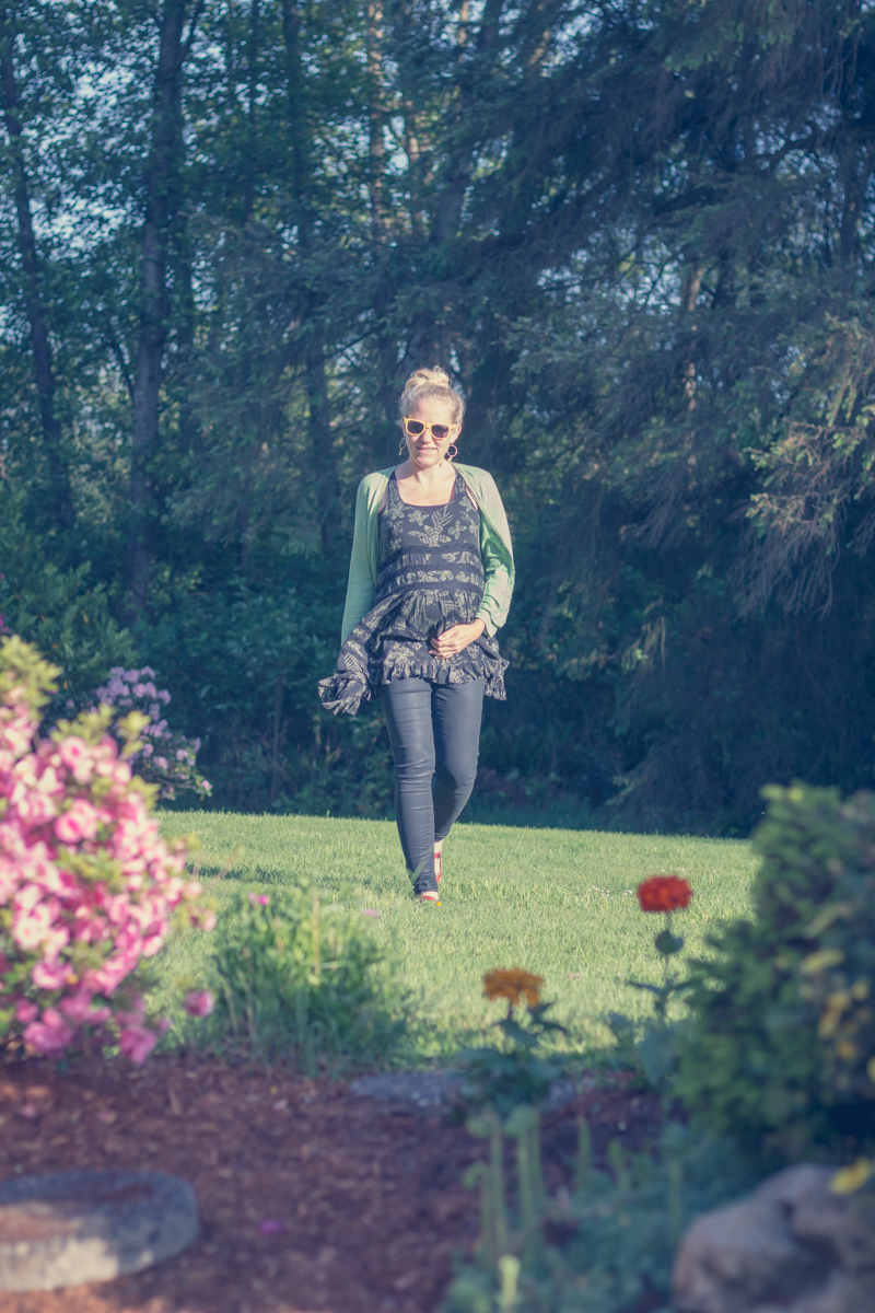 Extremely hot pregnant mom walking across grassy yard