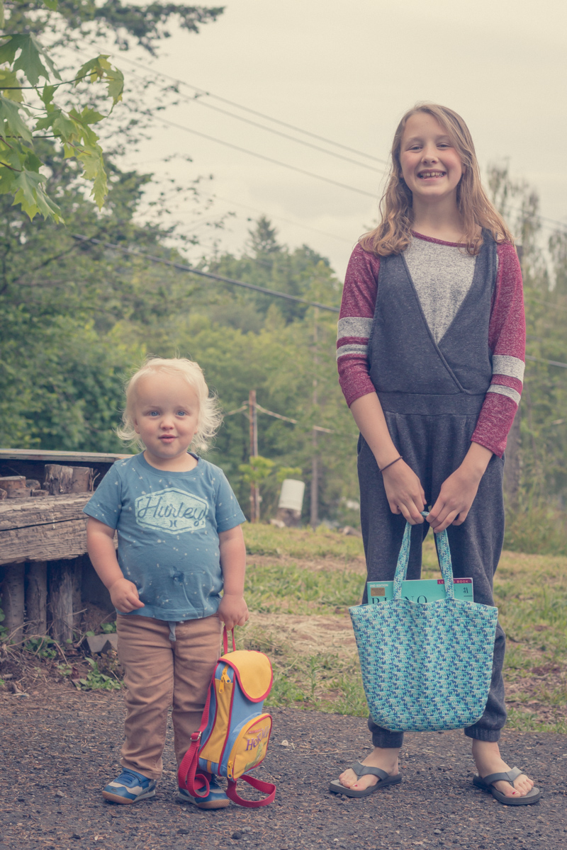 Two siblings heading to school outside