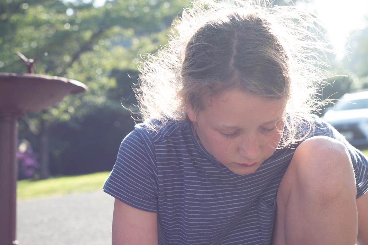 Girl playing outdoor in sunlight.jpg