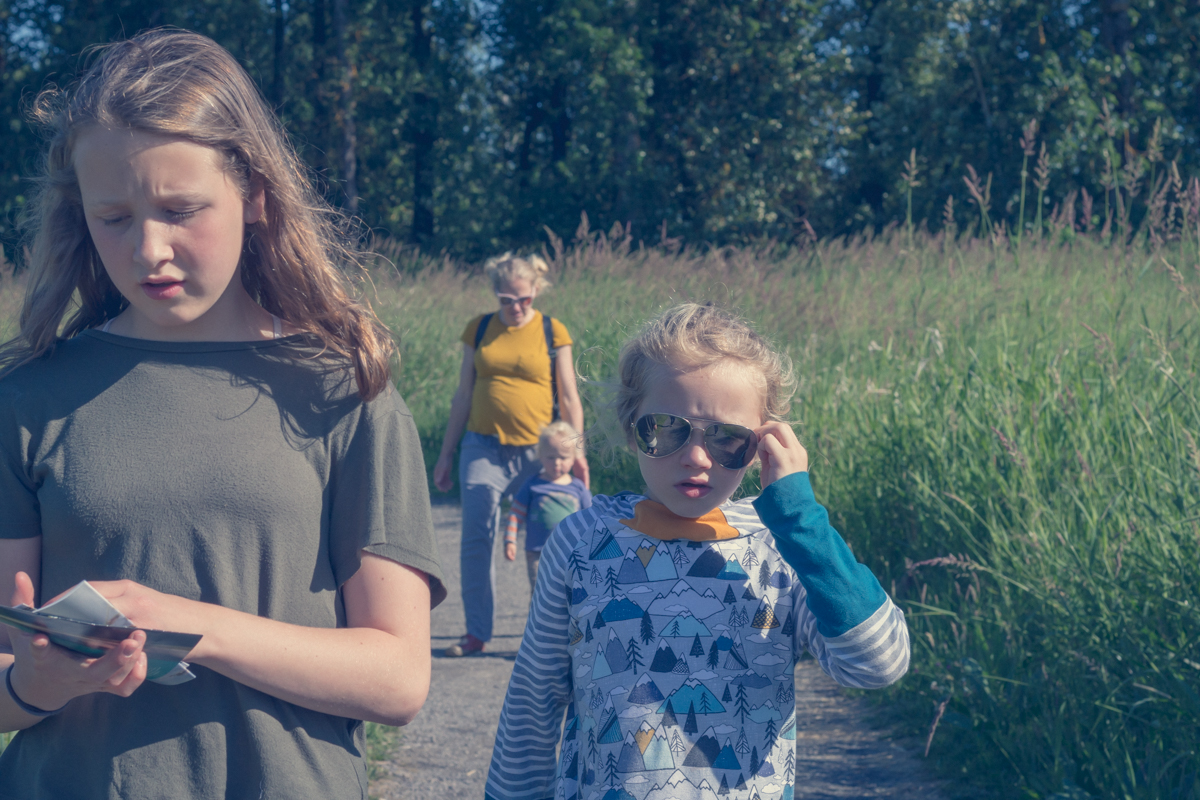 Family hiking with kids on summer day