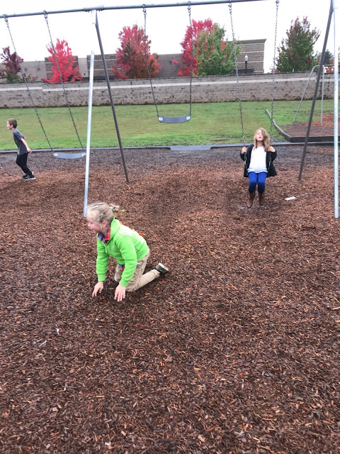 Third graders swinging on playground together