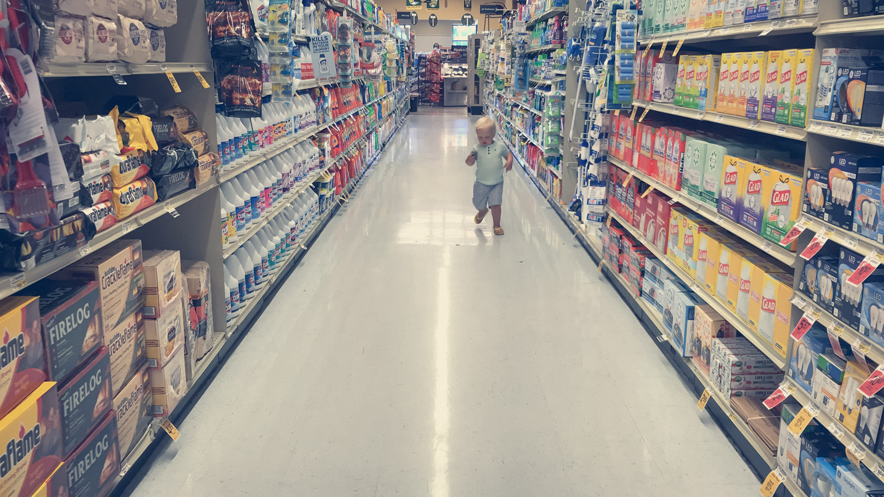 Two-year old boy shopping at the grocery