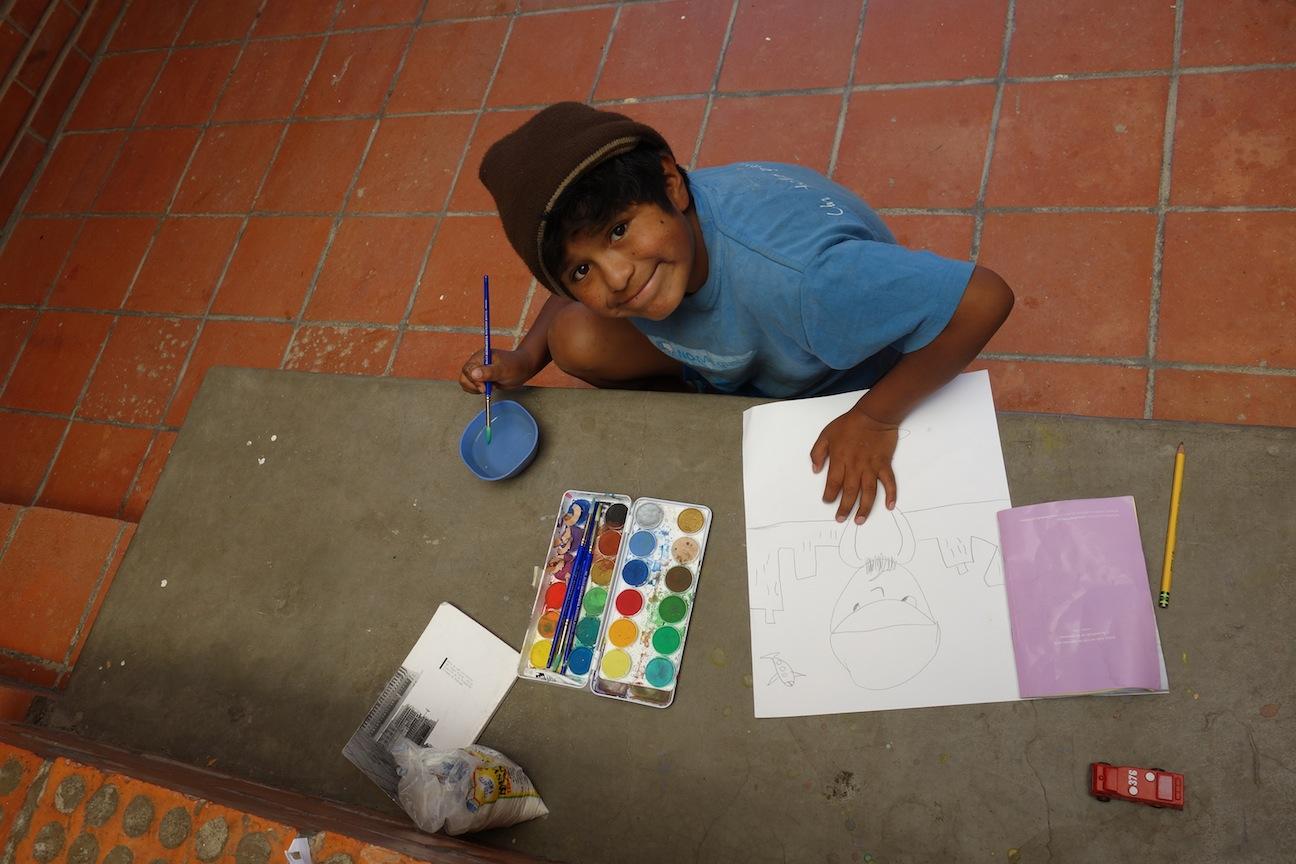 Roger painting after homework.JPG