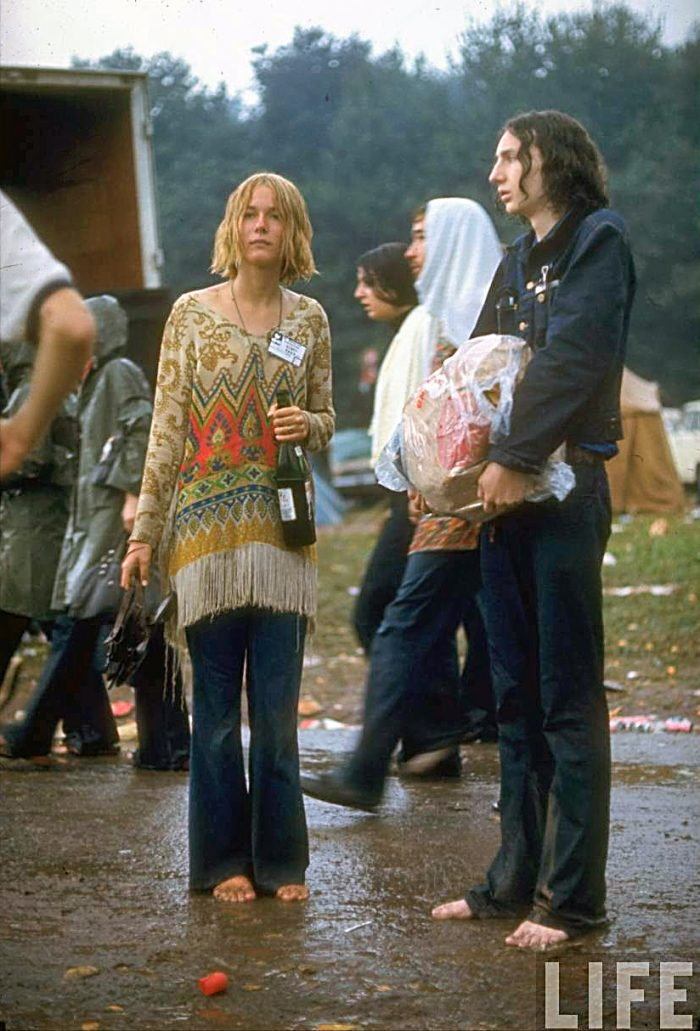 Woodstock-Photos-A-couple-standing-barefoot-in the mud at the Festival- Credit John-Dominis-Woodstock-1969-700x1031.jpg