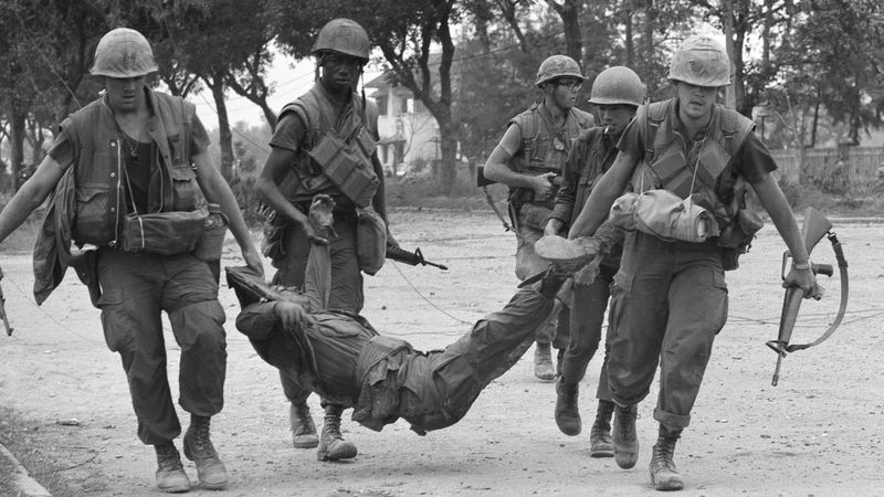 U.S. Marines drag casualty from street in Hue, Vietnam, Feb. 4, 1968. (Photo: Rick Merron)