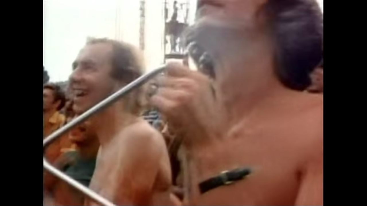 """During Santana's set at Woodstock 1969 fans were moved to """"play along"""" on instruments they brought from home. Who brings a Triangle to a rock concert?"""