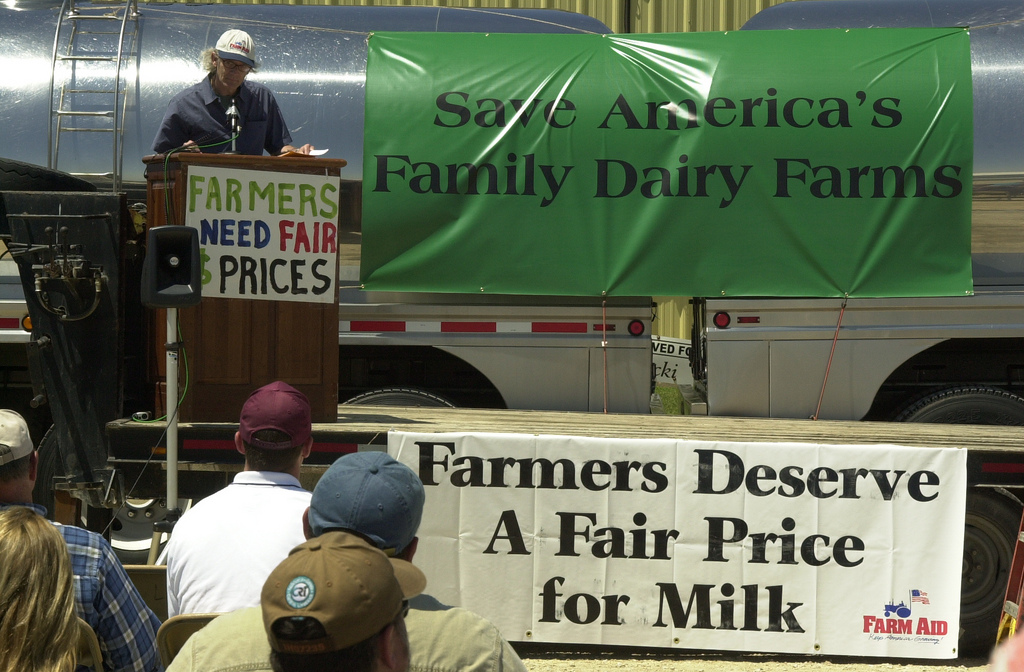 Farm Aid advocate Joel Morton at Dairy rally. Photo by Fritz Nordengren
