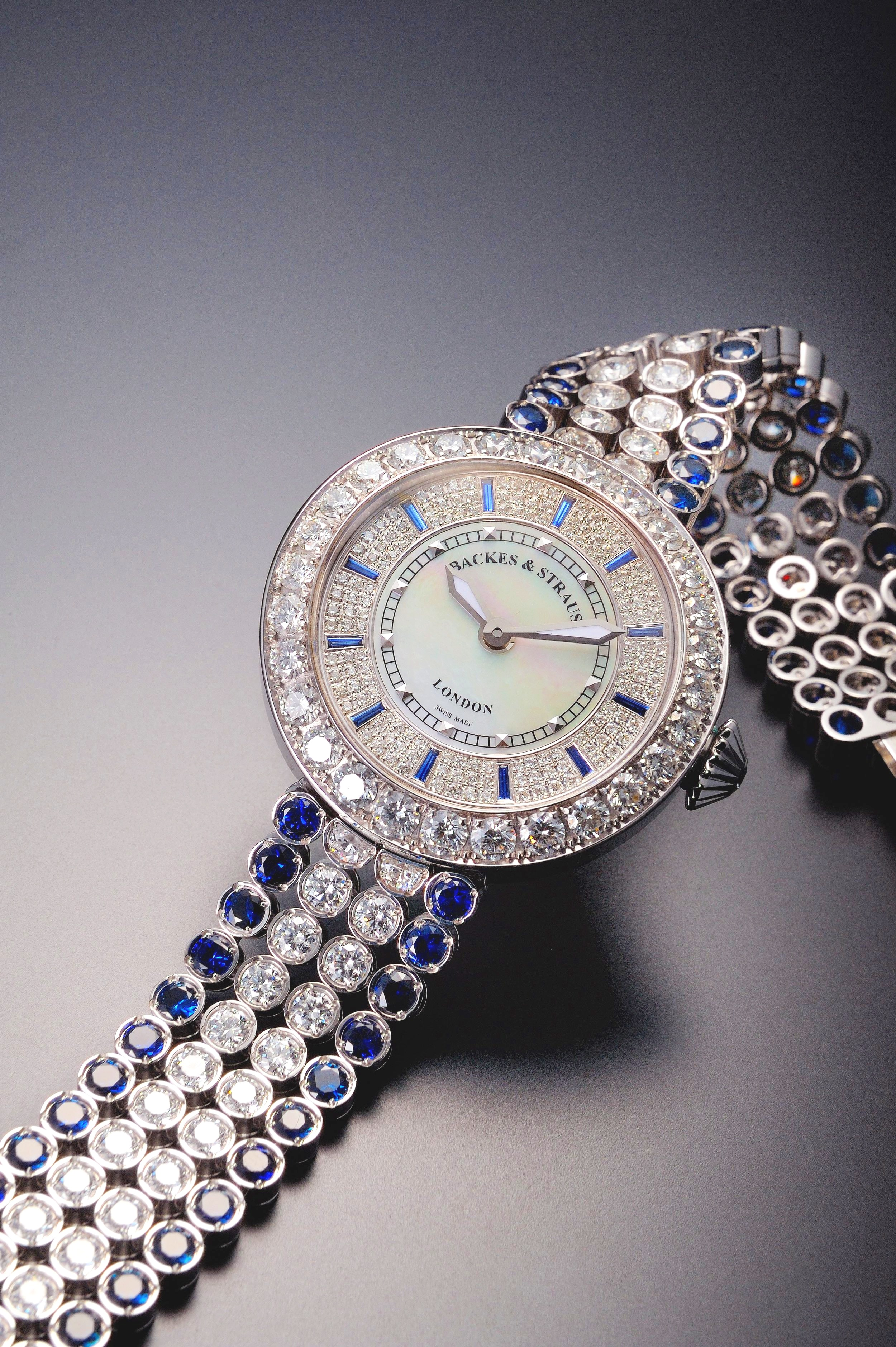 Round diamond watch with sapphires