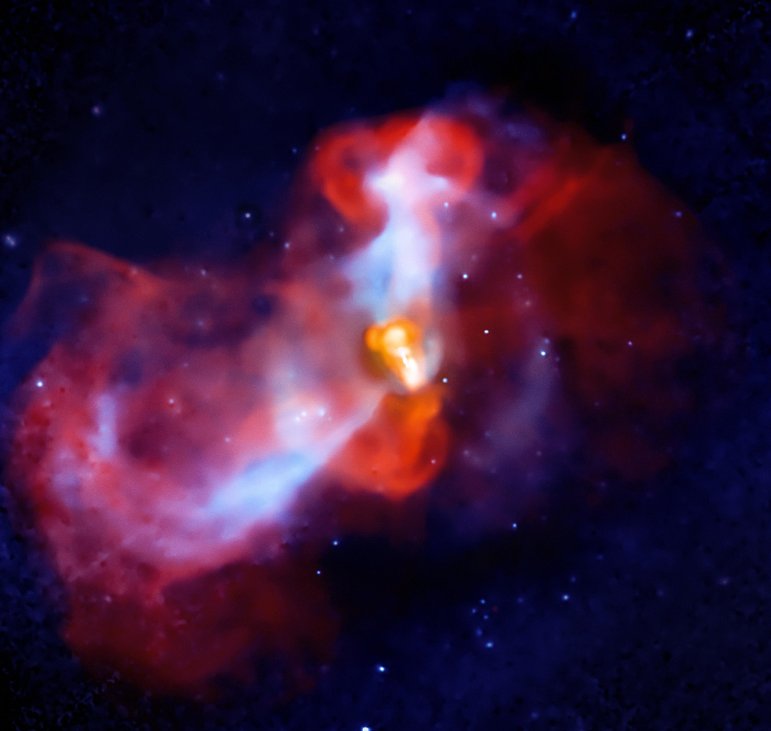 In this X-ray ( Chandra ) and radio ( VLA ) composite image, hot matter (blue in X-ray) from the Virgo cluster falls toward the core of M87 and cools, where it is met by the relativistic jet (orange in radio), producing shock waves in the galaxy's interstellar medium. Source: Wikipedia
