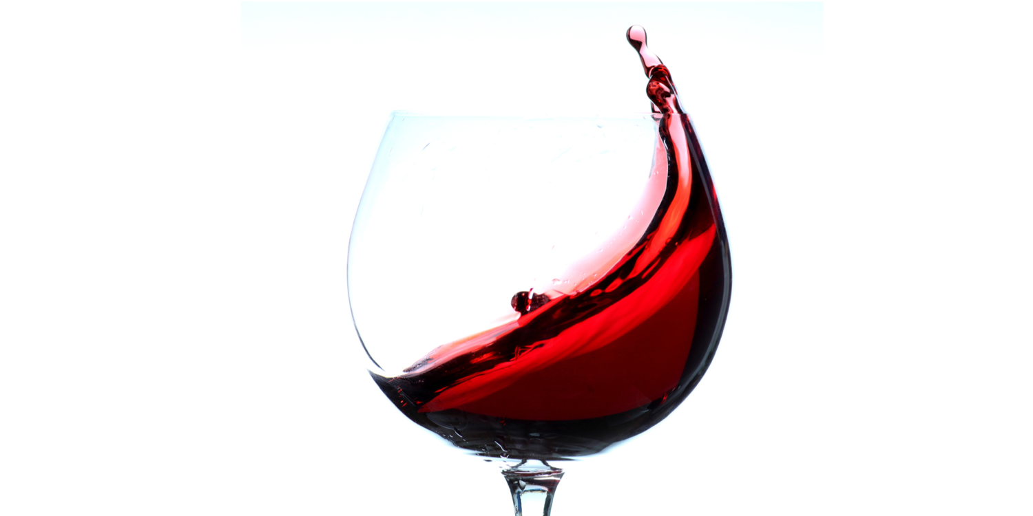 Red wine in glass.png