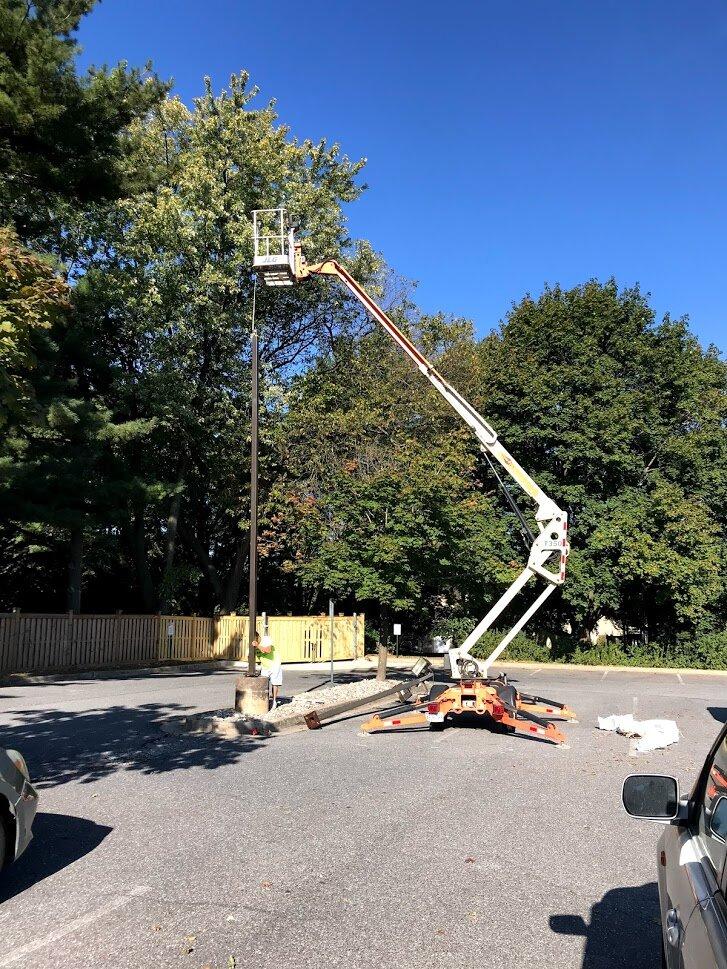 High efficient LED lights being installed in parking lot. Sept. 26, 2019