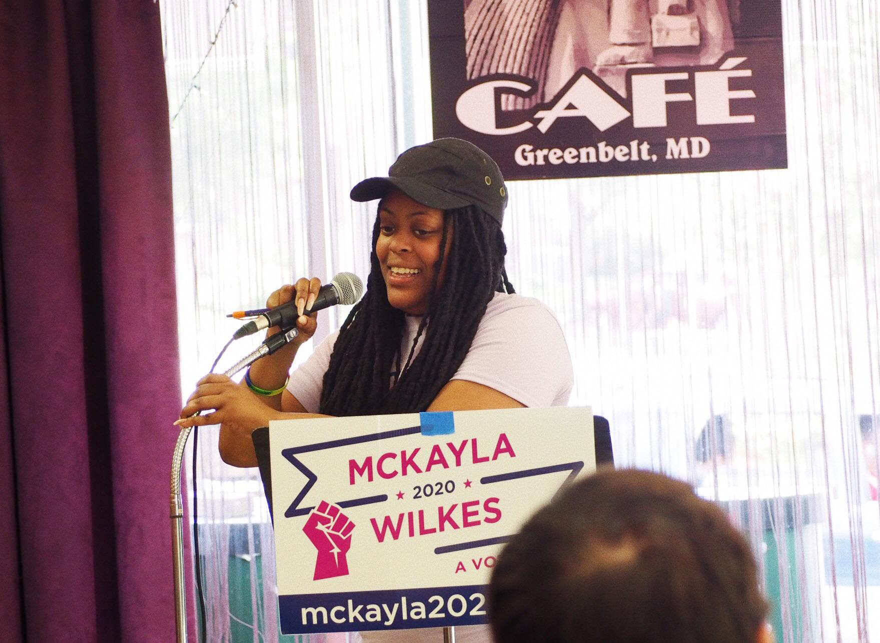 Mckayla speaking at the New Deal Cafe in Greenbelt, Maryland