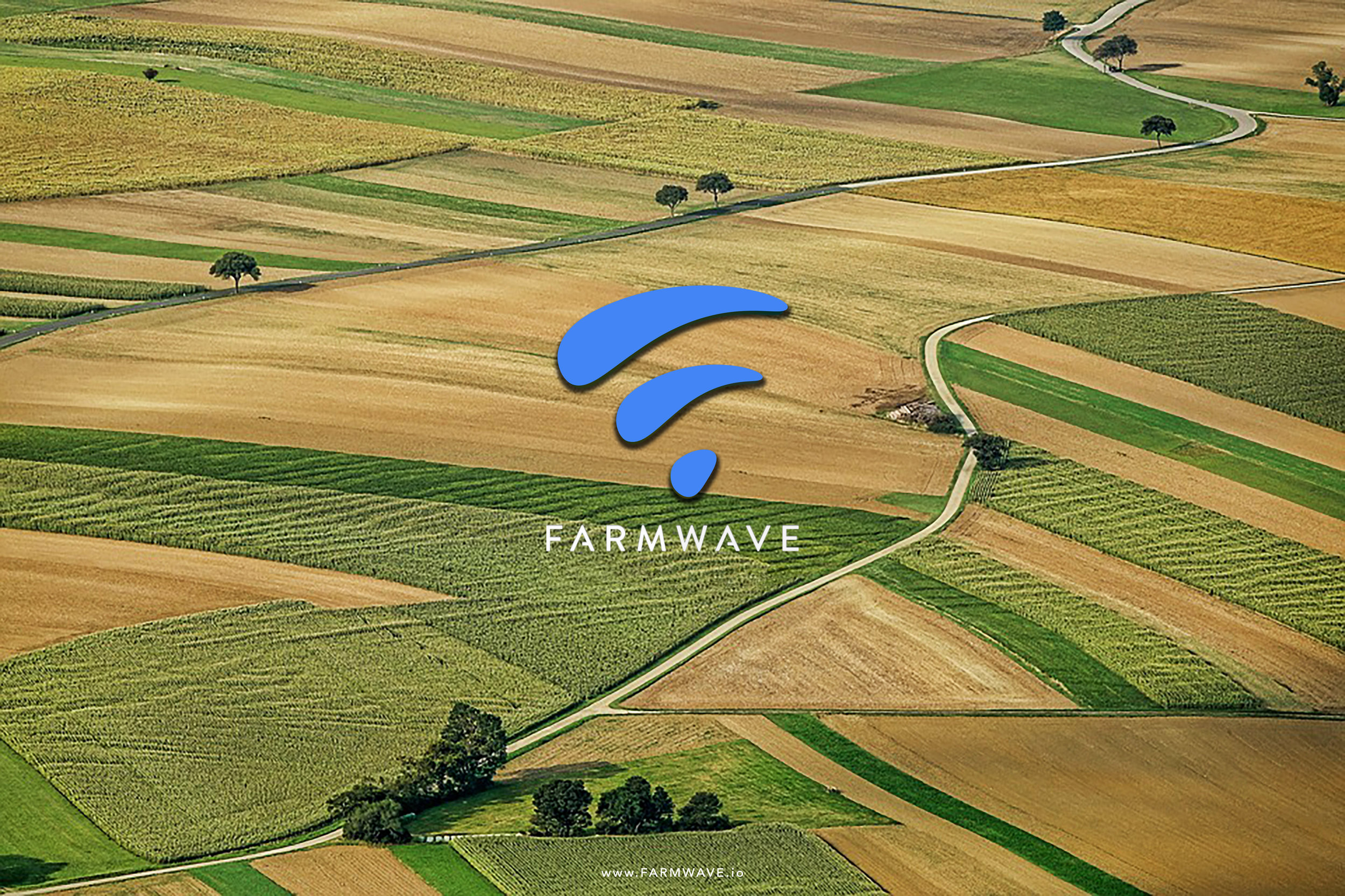 A drone shot of a fields with the Farmwave's logo dropped on top.