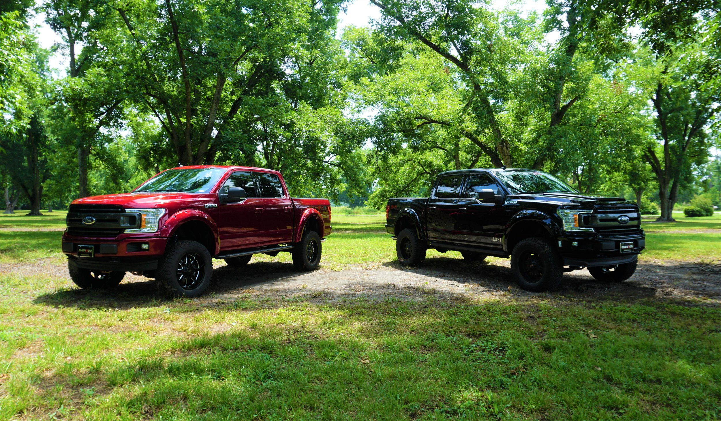 TWO TRUCKS IN THE SHADE