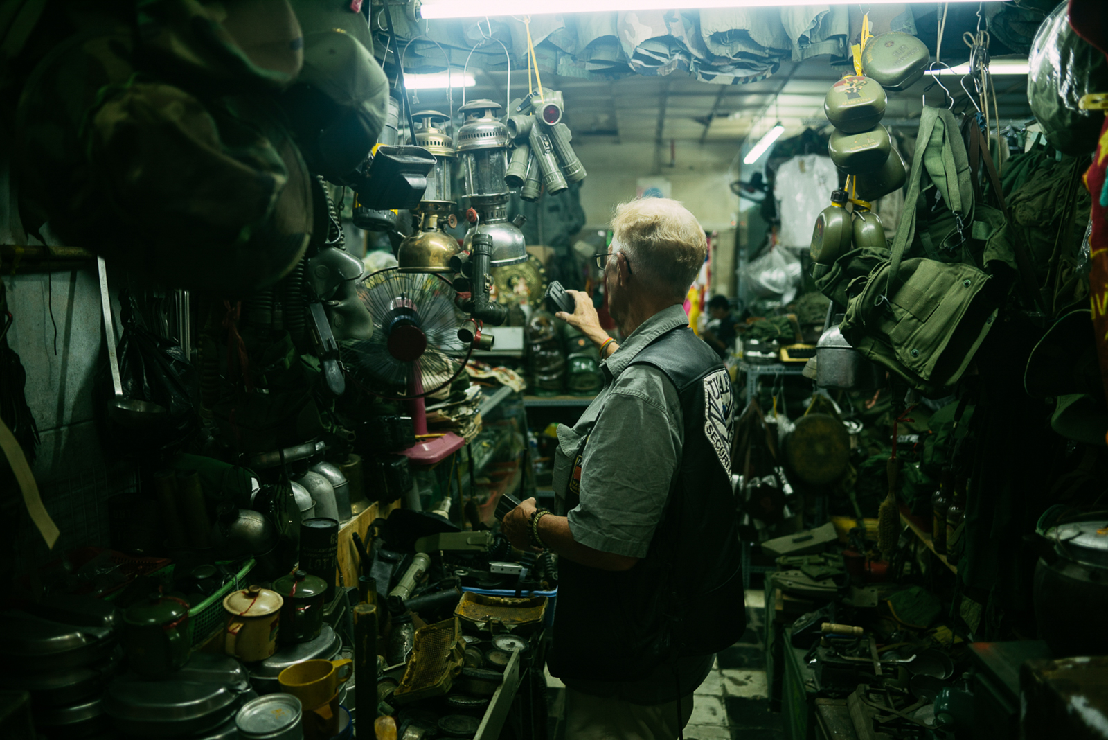 "A place of comfort for Bill is the flourishing black market at the Dan Sinh Market in Ho Chi Minh City. ""It makes me feel like a kid in a candy store,"" Bill explains during our visit. Despite terrible memories of the war and his own guilt, the old war relics give him a familiar feeling."