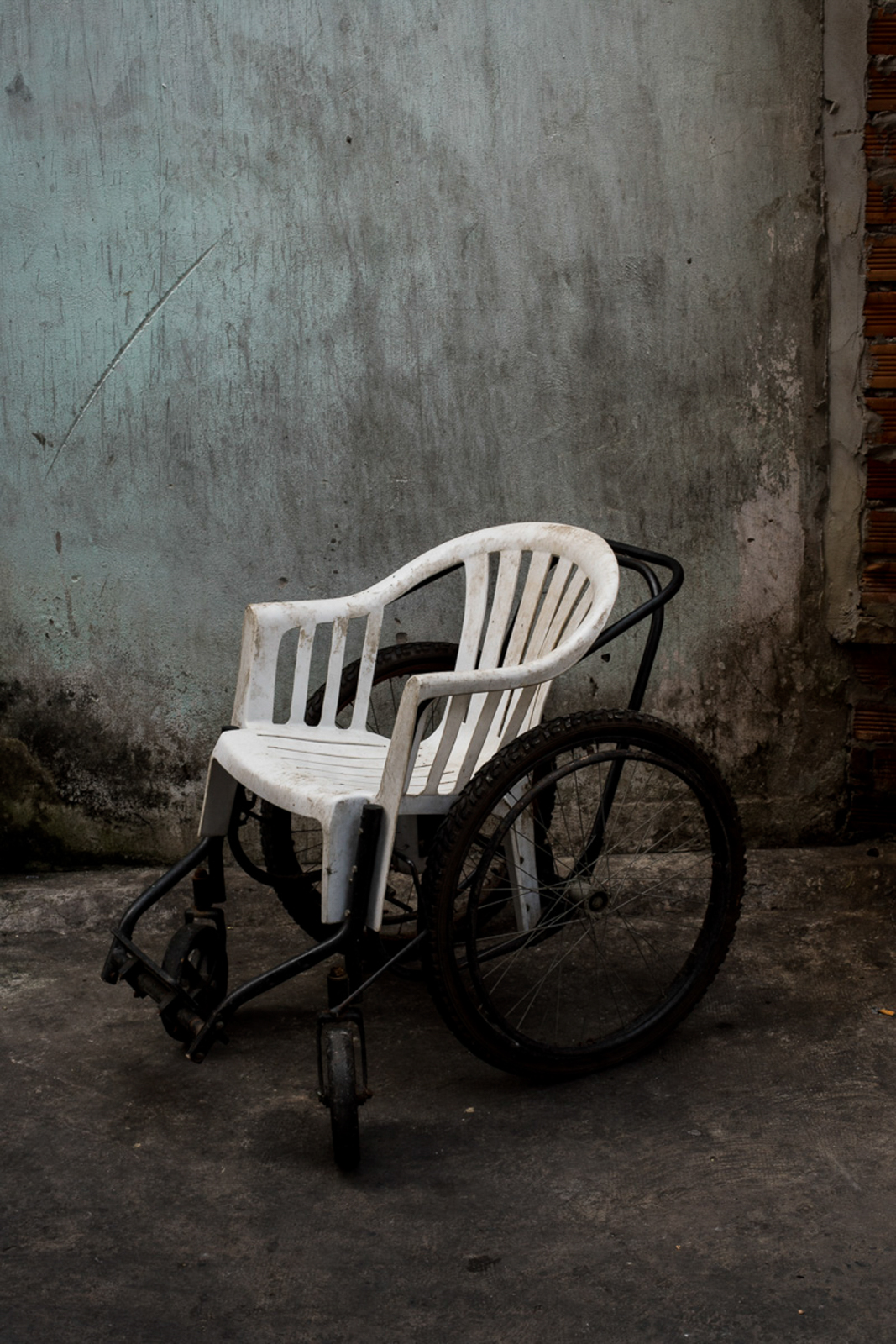 The Vietnamese community has found a way to support each other when there is very little official support available. This DIY wheelchair is made out of a plastic chair.