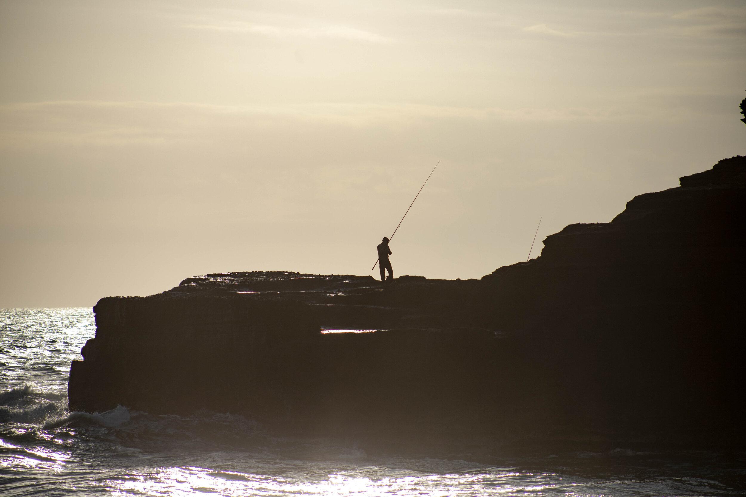 Tanah Lot fisherman.jpg
