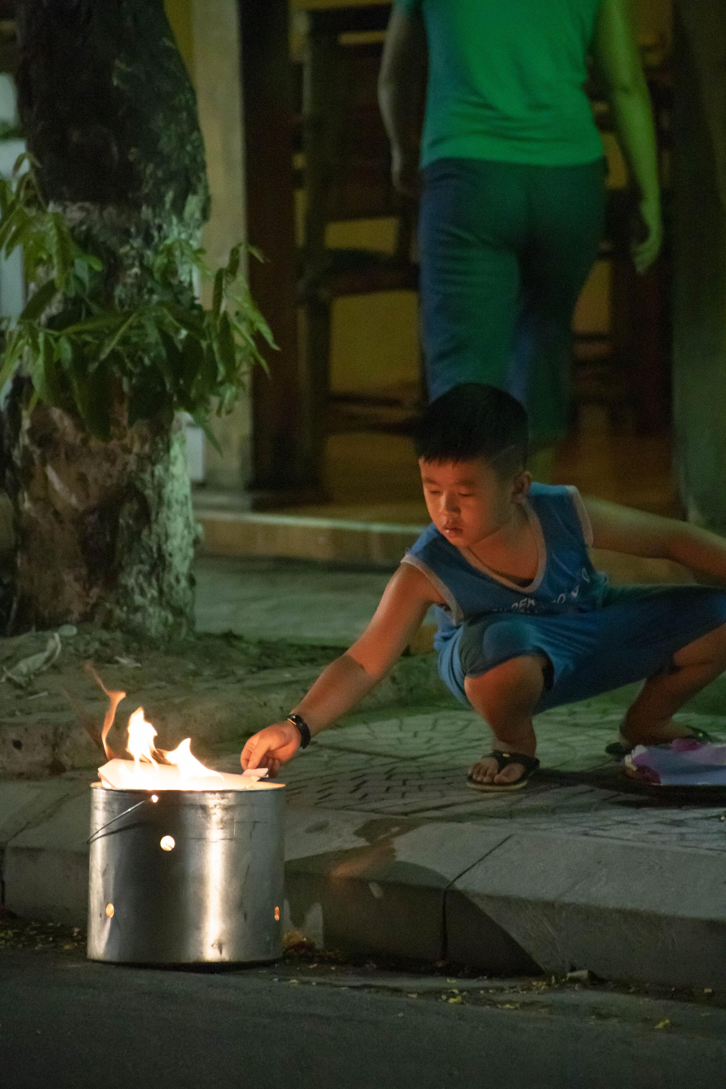 kid burning paper.jpg