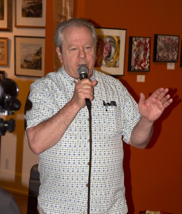 Grady Tarbutton promotes PhotoZone to the art walk crowd.