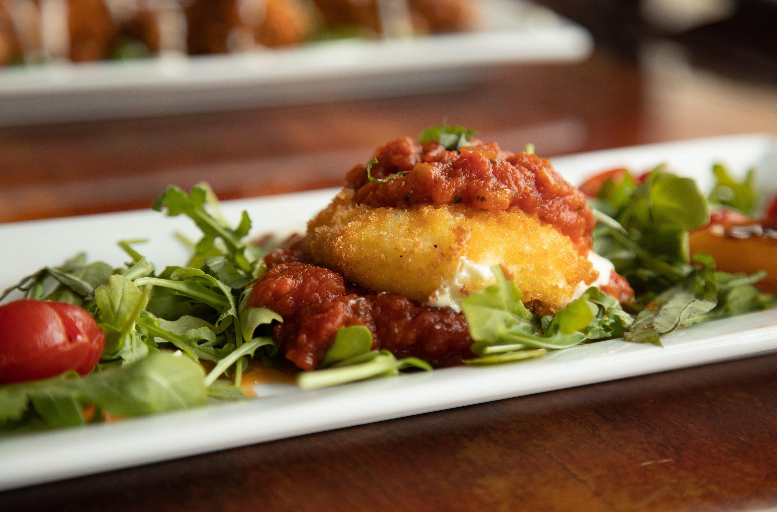 Signature Fried Burrata Salad - Delicately fried fresh mozzarella with a cream ricotta filling