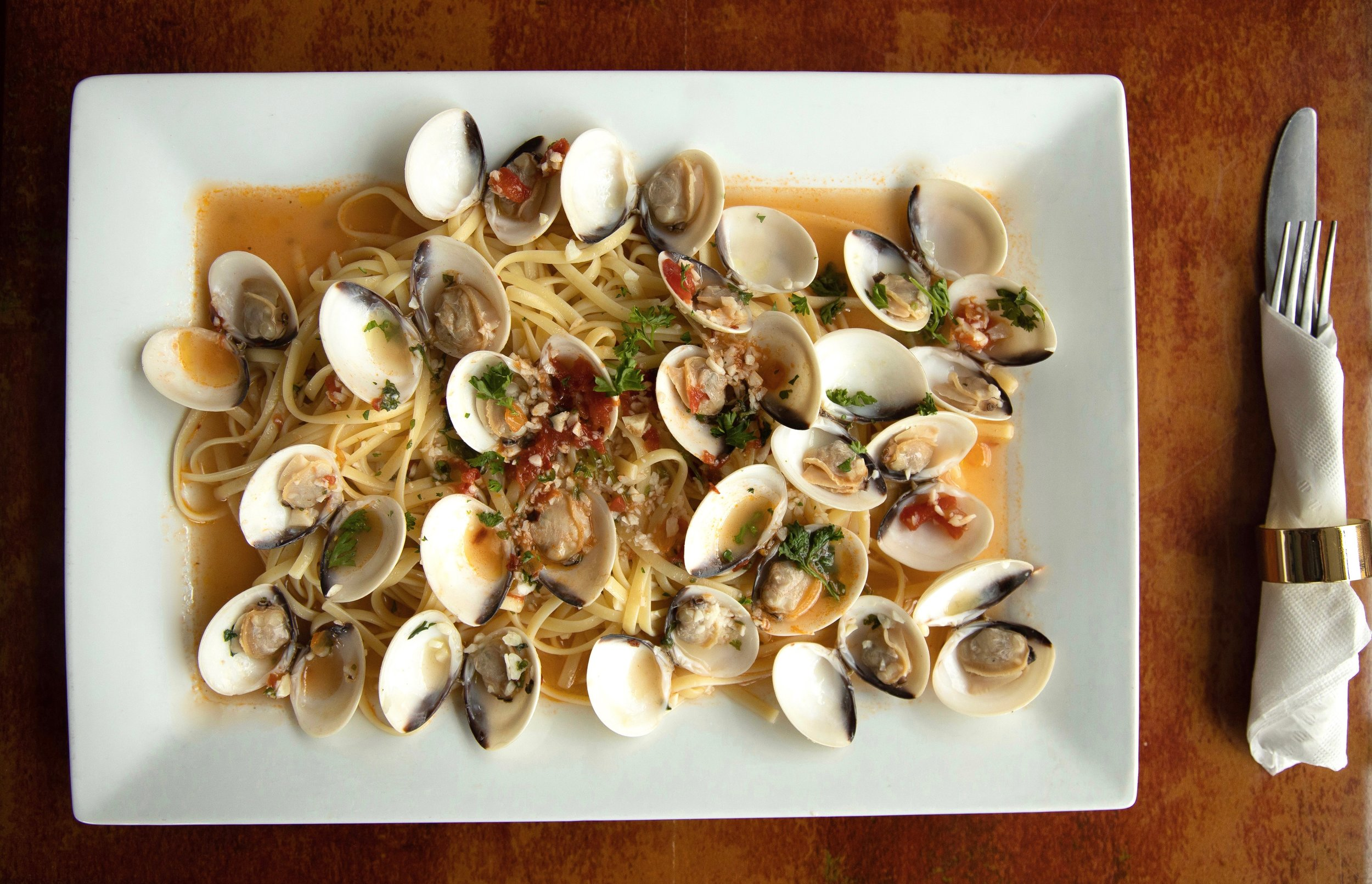Linguini with Clams - Little neck clams roasted in garlic white sauce