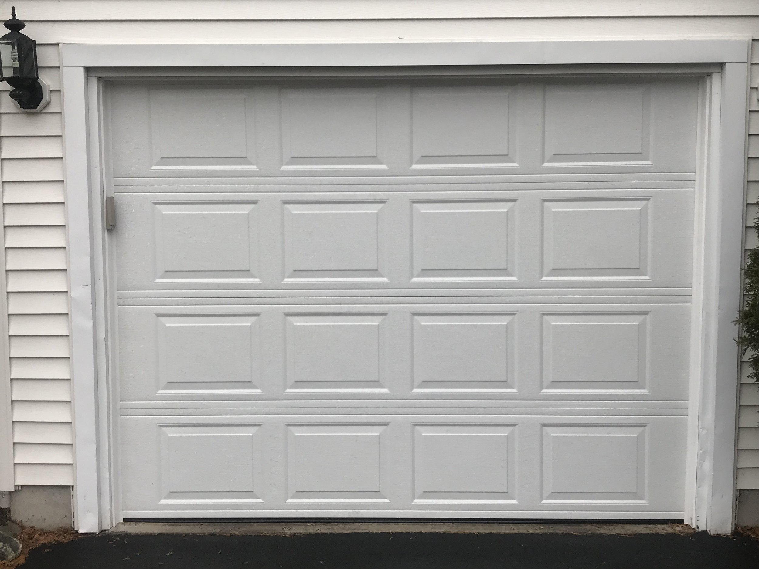 White Colonial Style Garage Door
